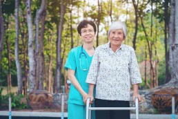 nurse with an elderly asian woman