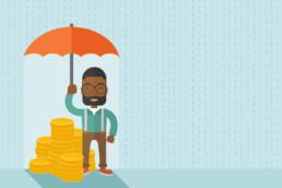 a businessman holding an umbrella over his money during rain