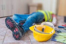 construction worker laying on his back hurt