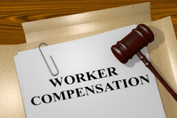 worker compensation file with judge's gavel